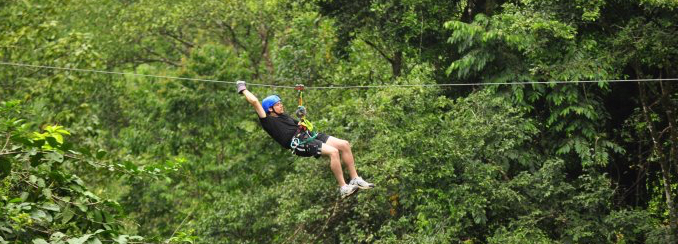 Joel ziplines during a staff retreat in Costa Rica