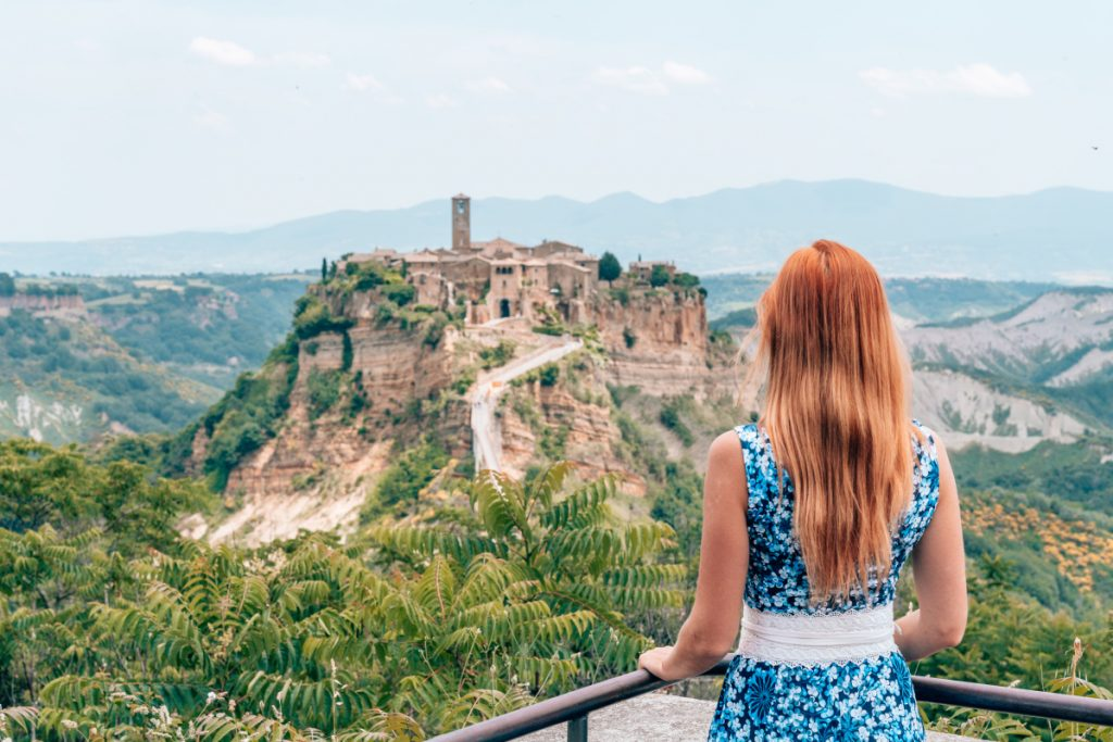 Anna Everywhere, a travel blogger, standing before a castle