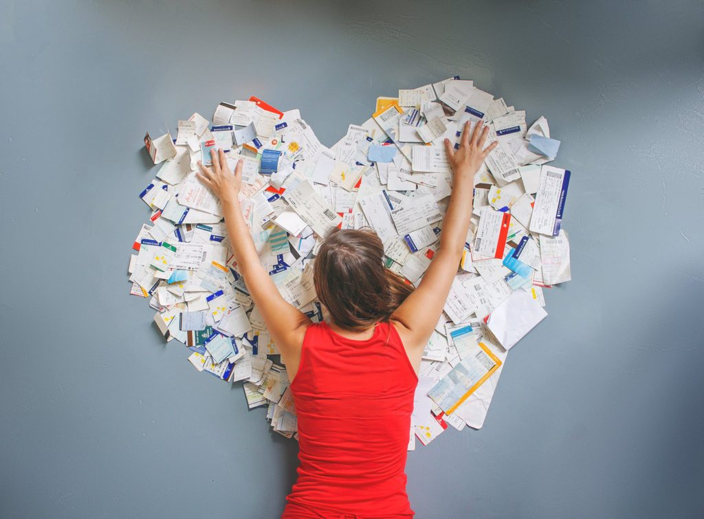 Mar from the travel blog Once In A Lifetime Journey, spreads out all of her boarding passes in a large heart shape