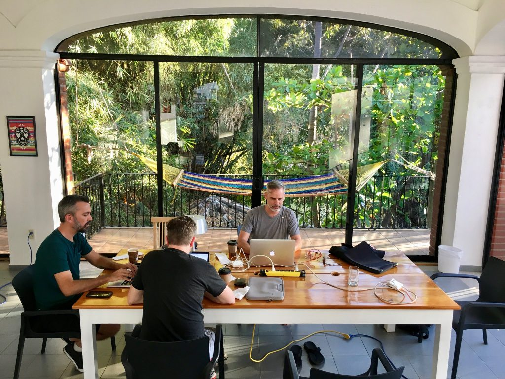 Peter, Joel & Alan working at a table