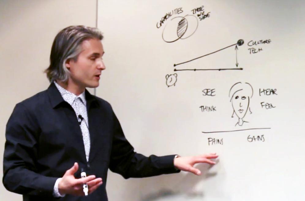 Kedron teaching at a whiteboard